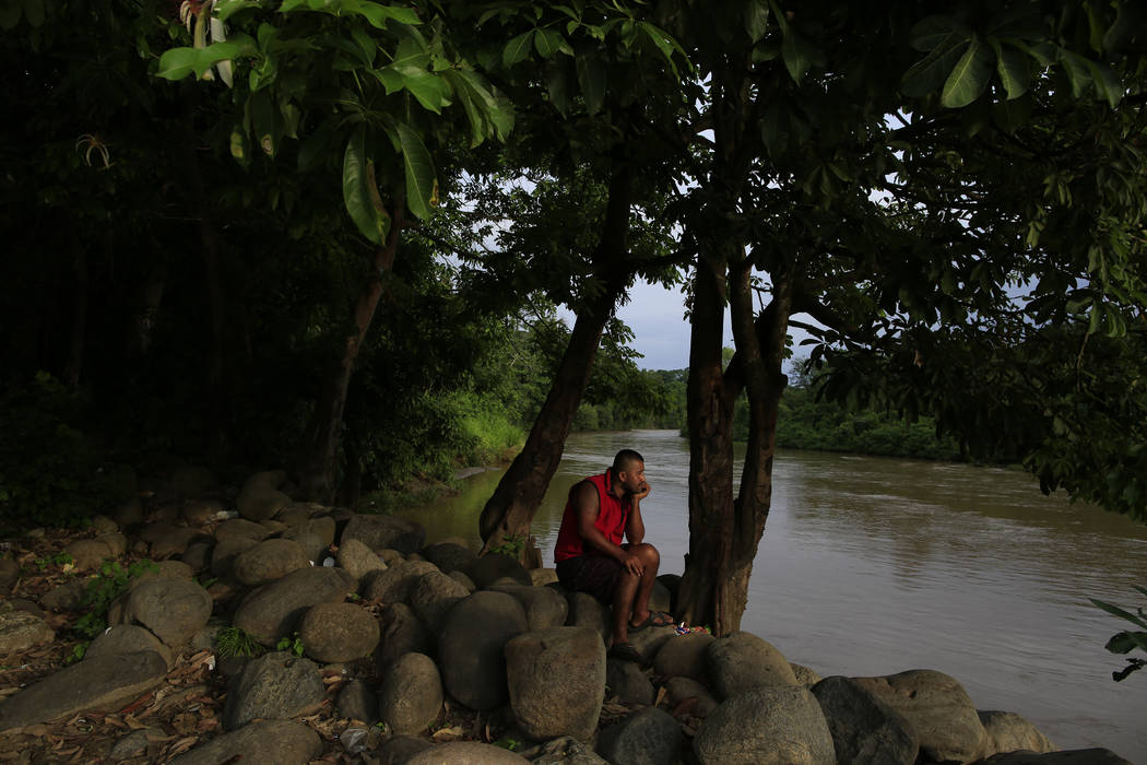 A local resident relaxes beside the Suchiate river in Frontera Hidalgo, Mexico, on the border w ...