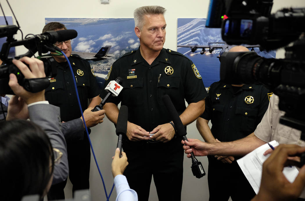 Okaloosa County, Fla.,Sheriff Larry Ashley fields questions from the media after Florida Gov. R ...