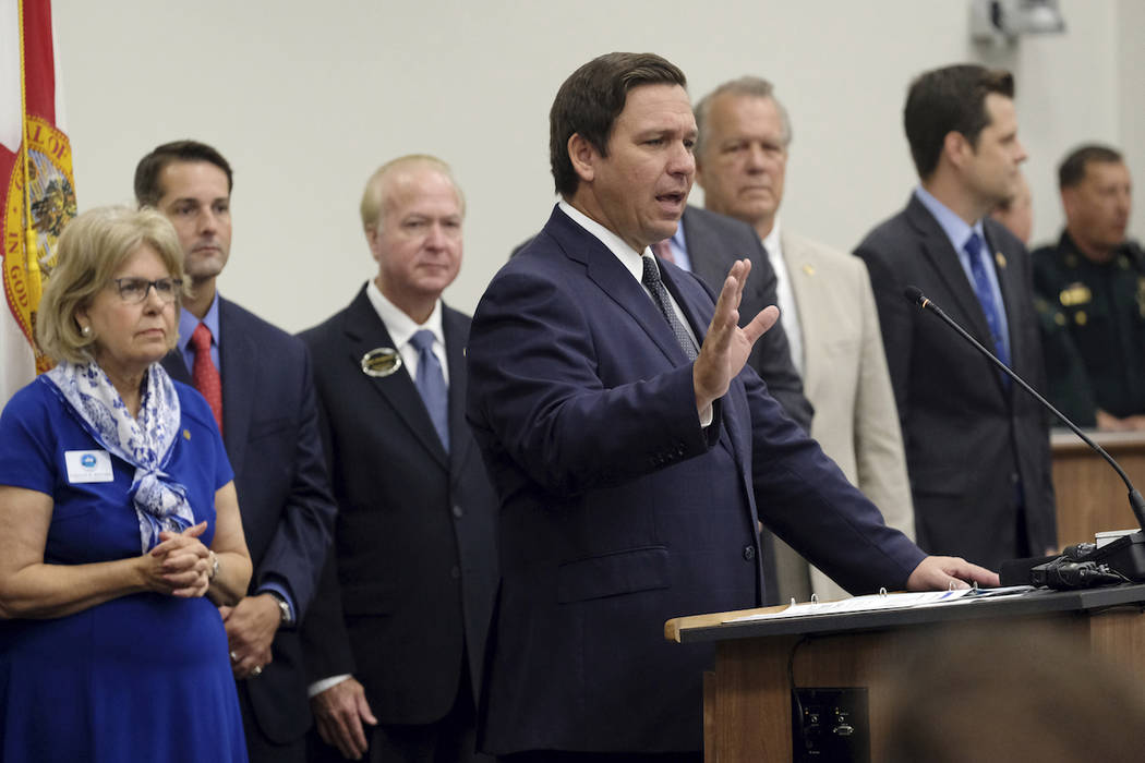Florida Governor Ron DeSantis addresses the audience before he signs the Sanctuary City bill at ...