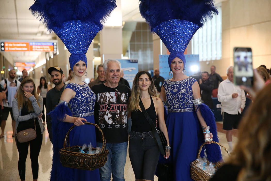 Yaron Yosef, second from left, with his daughter Nataly, take a photo with showgirls Jennifer A ...
