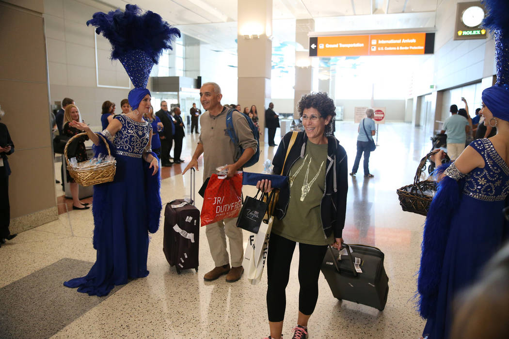 Igal Cohen, left, and his wife Noga, arrive to McCarran International Airport in Las Vegas, Fri ...