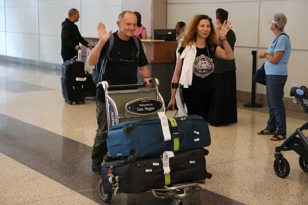 Israel Lavi, left, and his wife Ruth, wave as they arrive to McCarran International Airport in ...