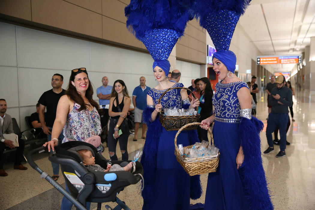 Tamar Menashe, from left, with her 3-month-old son Refael, interact with the showgirls Jennifer ...