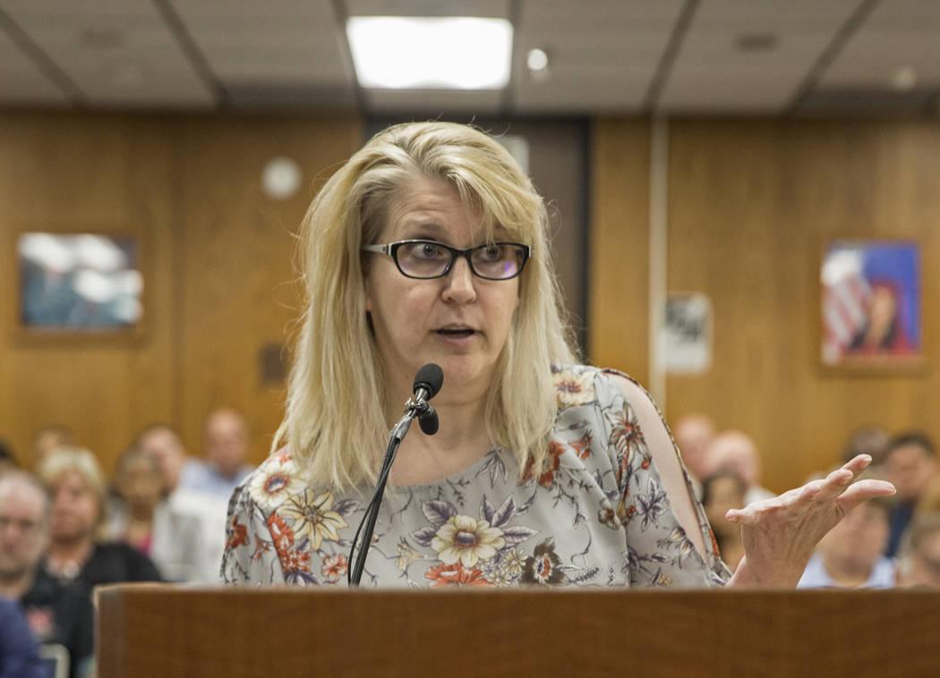 Amy Richmond, a parent and teacher at Palo Verde High School, addresses the Clark County School ...