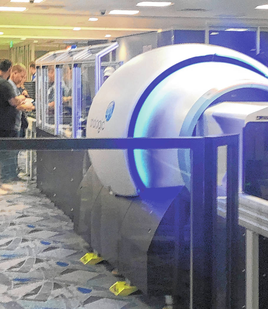 McCarran International Airport is the latest facility to test out a new 3-D security scanner ai ...