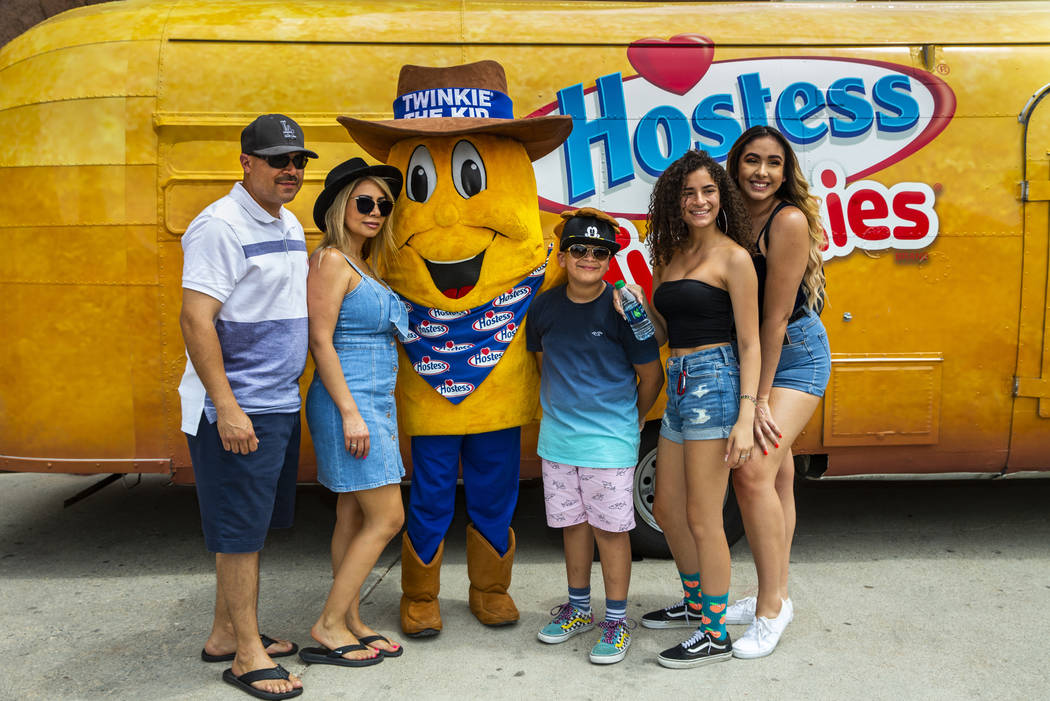 Twinkie the Kid poses with a family of Los Angeles while on a stop at the Hoover Dam in celebra ...