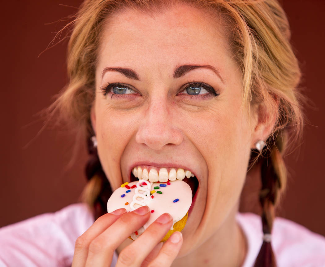 Hostess promoter Casey Weems samples a Hostess Birthday Cupcake while on a stop at the Hoover D ...