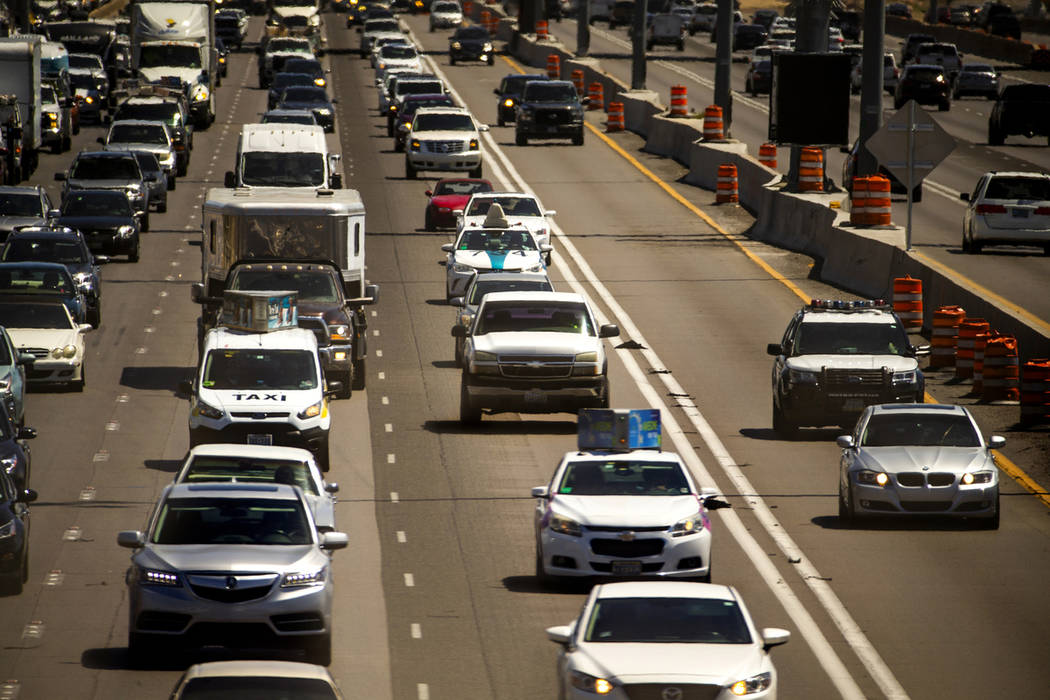 A police vehicle travels behind another traveling in the HOV lane northbound on Interstate 15 a ...