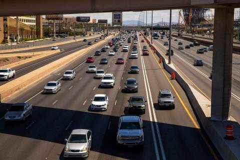 Fewer vehicles travel in the HOV lane northbound on Interstate 15 about Tropicana Avenue on Wed ...
