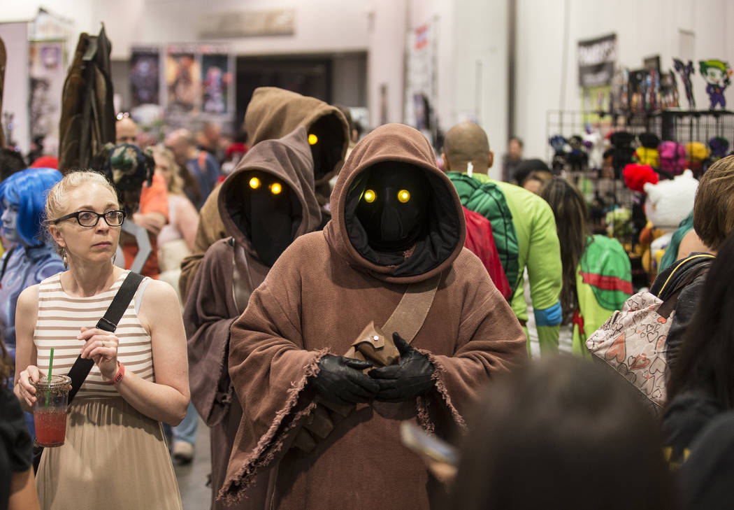 """Characters inspired by the """" Star Wars"""" series walk the North Halls during the Amazin ..."""