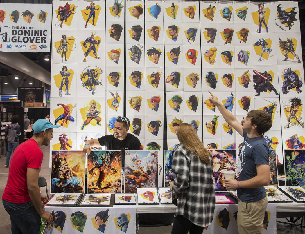 Artist Dominic Glover, second from left, talks with comic fans during the Amazing Las Vegas Com ...