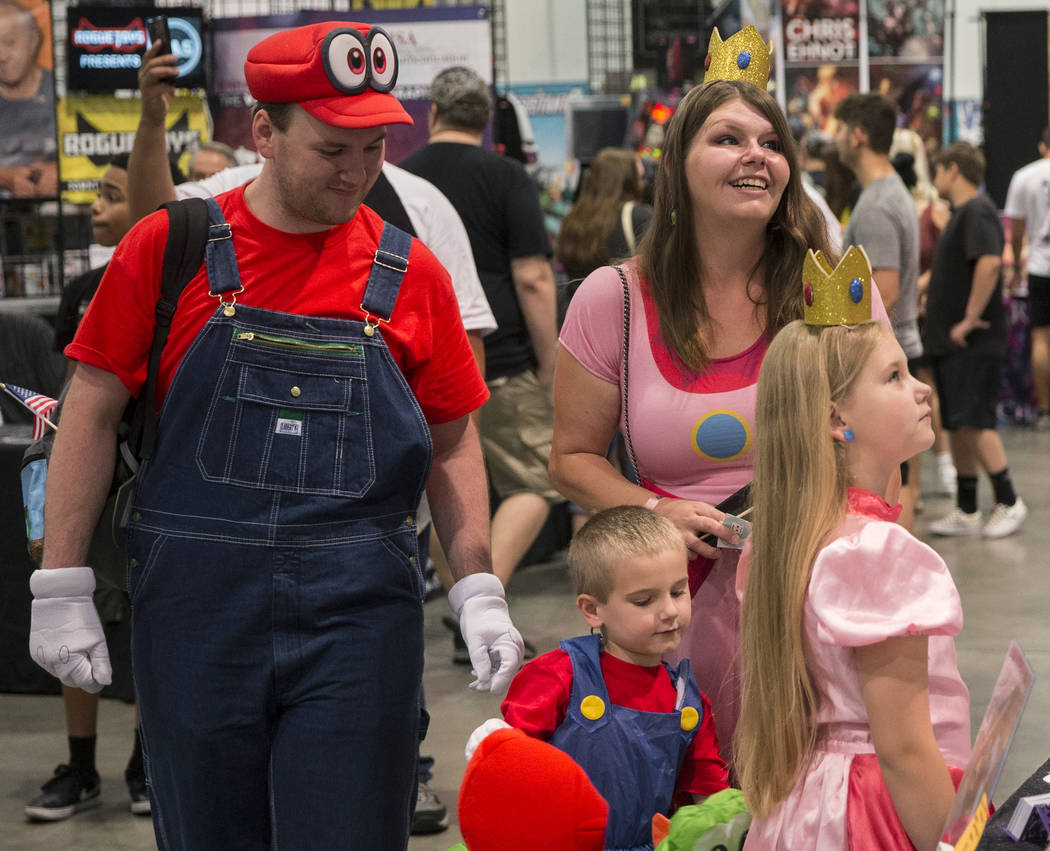 Scott McClain, left, with son Ethan, 4, wife Kylah and daughter Ashlynn, 8, explore the North H ...