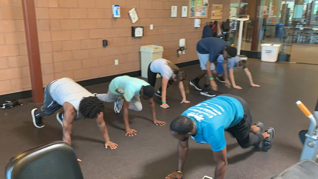 Courtney Woods does push ups alongside teens participating in his Power Hour class at the SkyVi ...