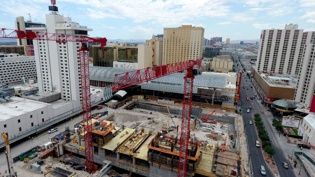 Two cranes tower over the Circa hotel casino construction site on the edge of the Fremont Stree ...