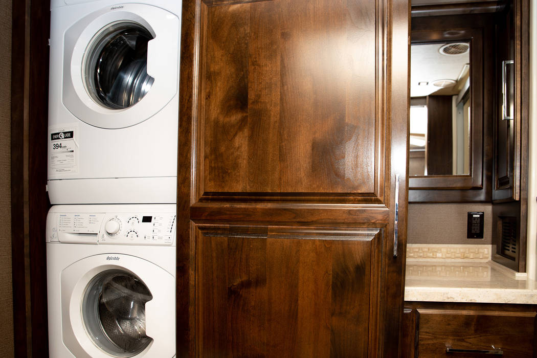 A sliding door in the master bath reveals a stackable washer and dryer. (Tonya Harvey/PBTH)