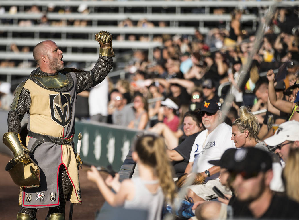 Lee Orchard, aka The Golden Knight, left, fires up the crowd during the Battle For Vegas Charit ...