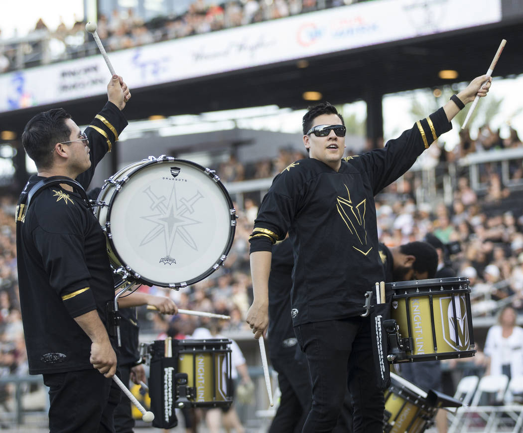 The Golden Knights Knight Line drummers perform before the start of the Battle For Vegas Charit ...
