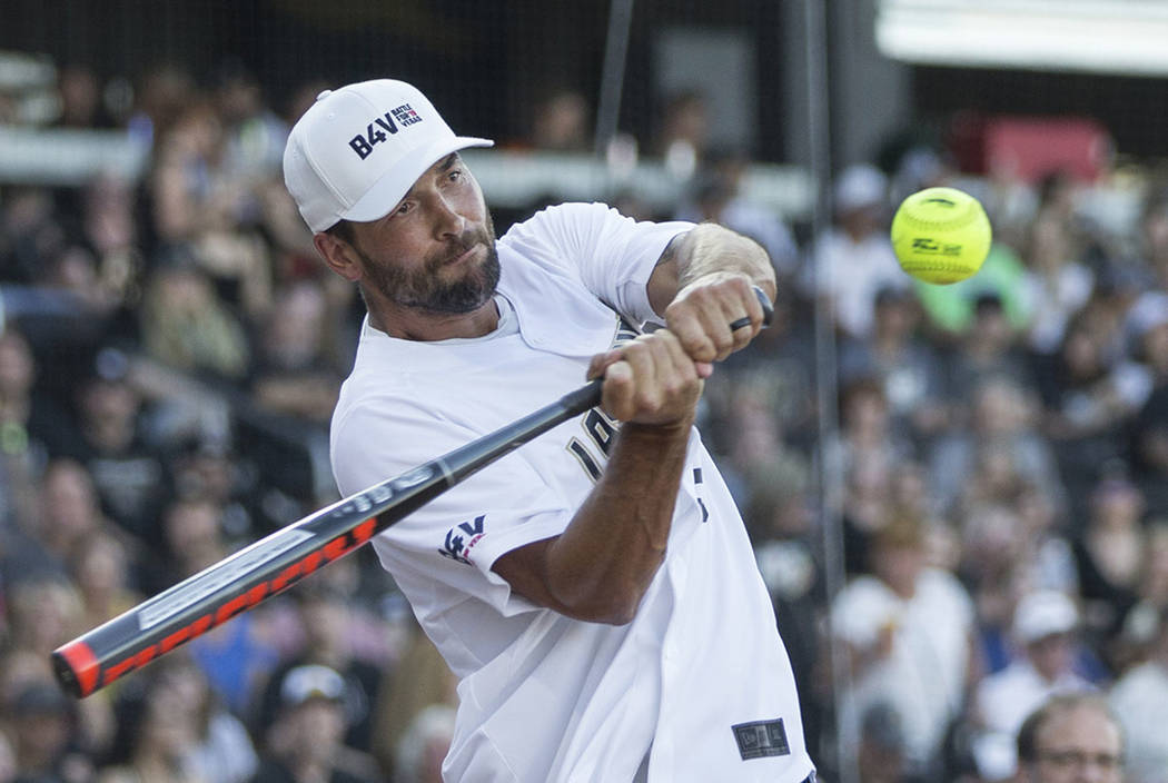 Golden Knights defenseman Deryk Engelland takes a swing during the home run derby at the Battle ...