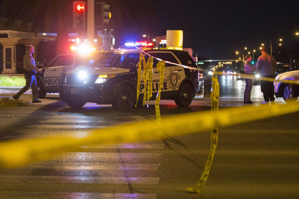 Las Vegas police investigate an officer involved shooting in the area of West Sahara Avenue and ...