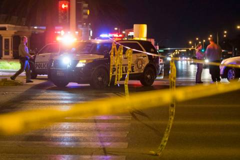 Las Vegas police investigate an officer-involved shooting in the area of West Sahara Avenue and ...