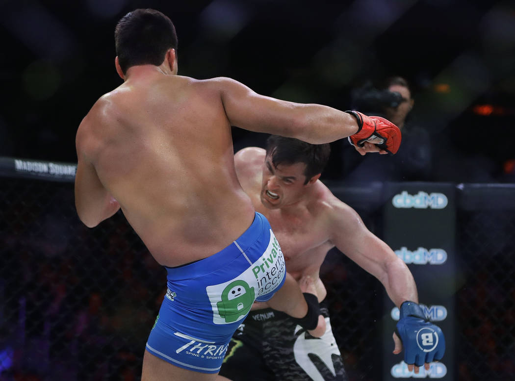 Brazil's Lyoto Machida, left, kicks Chael Sonnen during the first round of a light heavyweight ...