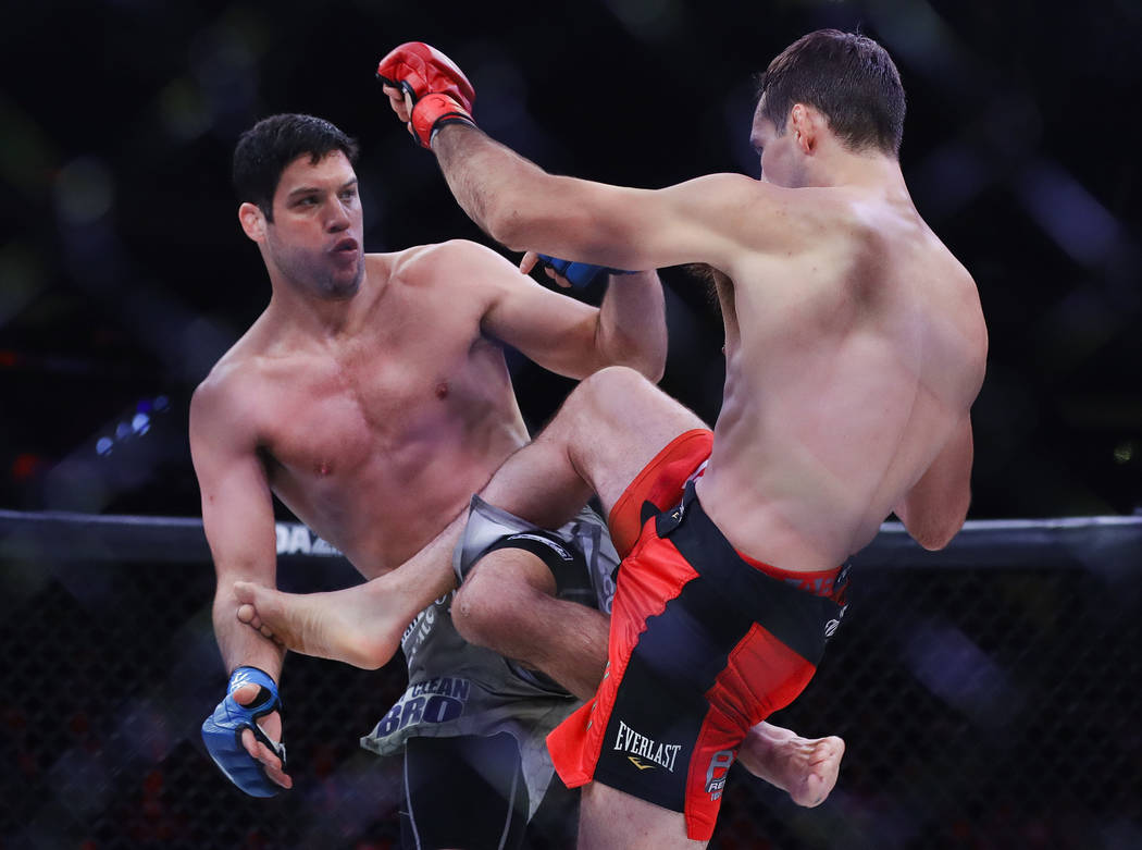 Neiman Gracie, left, exchanges kicks with Canada's Rory MacDonald during the first round of a w ...