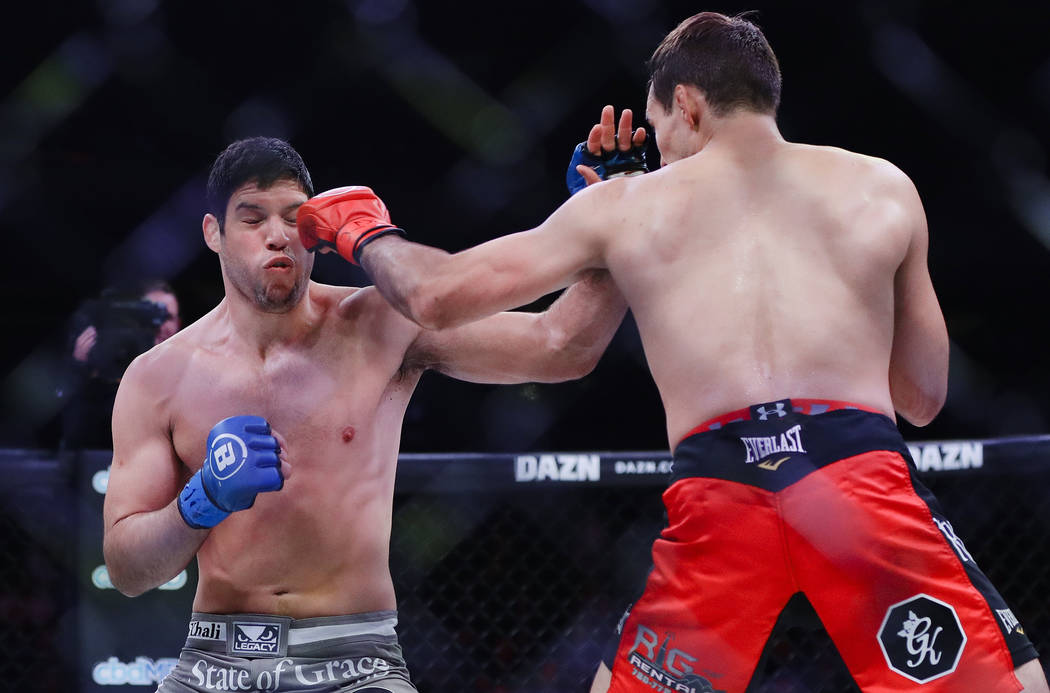 Canada's Rory MacDonald, right, punches Neiman Gracie during the first round of a welterweight ...