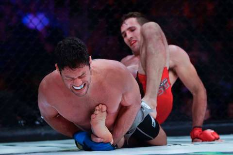 Neiman Gracie, left, grimaces during the second round against Canada's Rory MacDonald in a welt ...