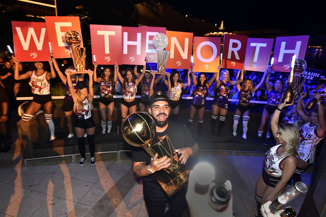LAS VEGAS, NEVADA - JUNE 14: Drake carries the Larry O'Brien NBA Championship Trophy as he cele ...