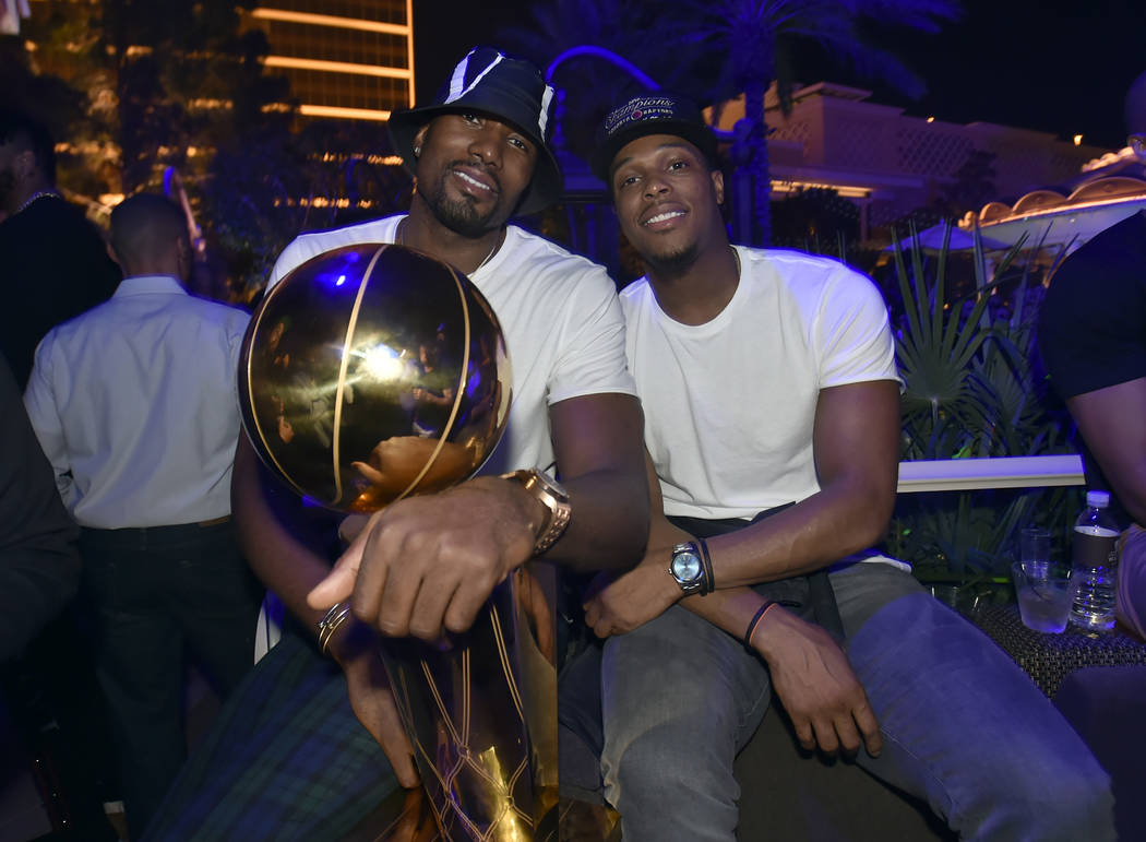 LAS VEGAS, NEVADA - JUNE 14: Serge Ibaka (L) and Kyle Lowry of the Toronto Raptors celebrate th ...