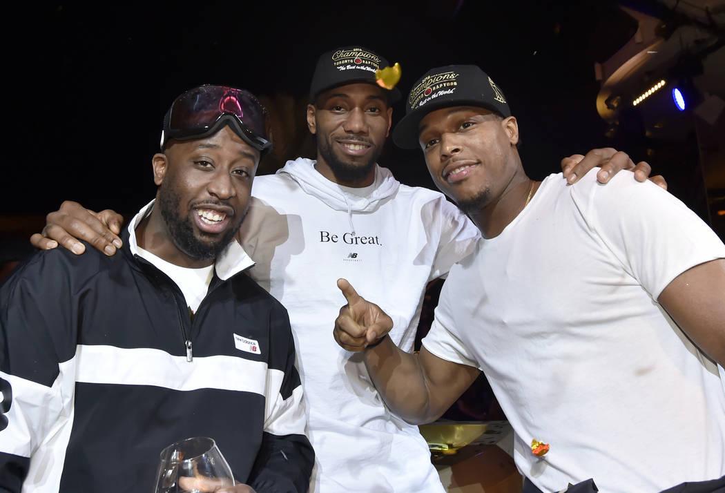 LAS VEGAS, NEVADA - JUNE 14: Kawhi Leonard (C) and Kyle Lowry (R) of the Toronto Raptors celeb ...
