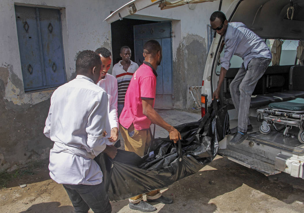 The body of one of the victims of a bomb attack is brought to the morgue at a hospital in the c ...
