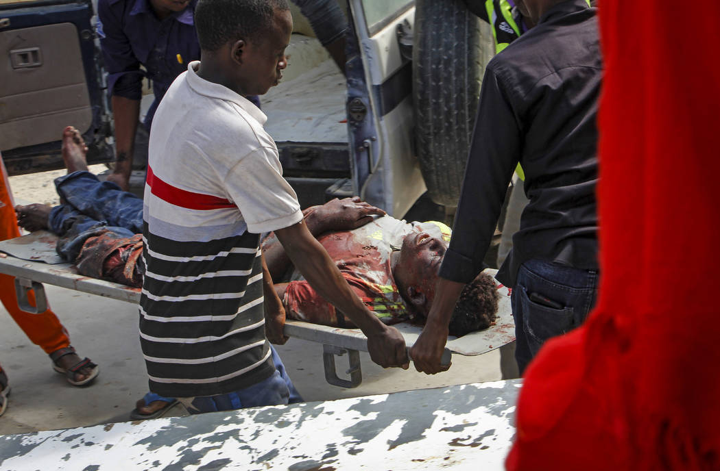 Medical workers help a man who was wounded in a bomb attack, at a hospital in the capital Mogad ...