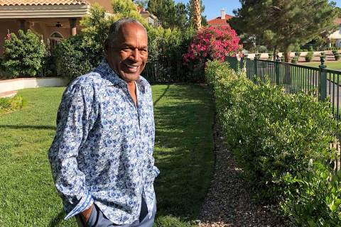 This photo provided by Didier J. Fabien shows O.J. Simpson in the garden of his Las Vegas area ...