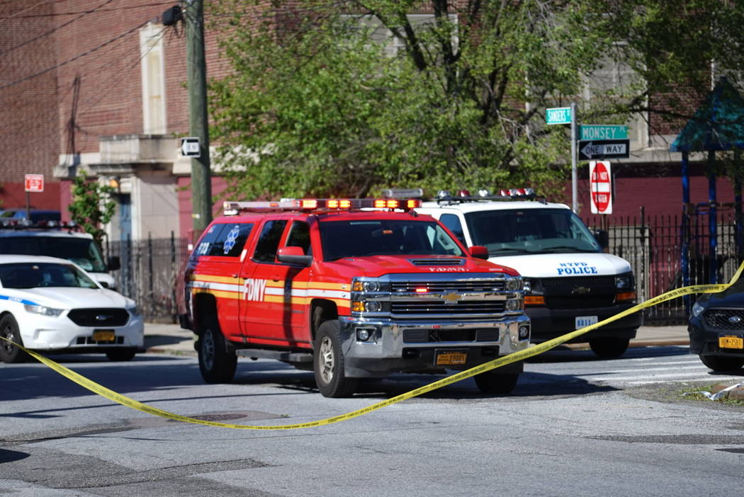Police tape cordoned off the street along Wilcox Street behind the 121st Precinct station house ...