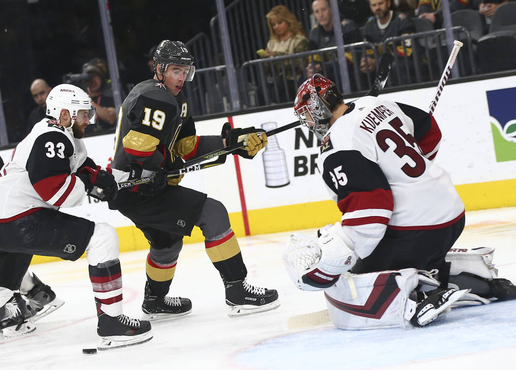 Golden Knights right wing Reilly Smith (19) moves the puck around Arizona Coyotes goaltender An ...