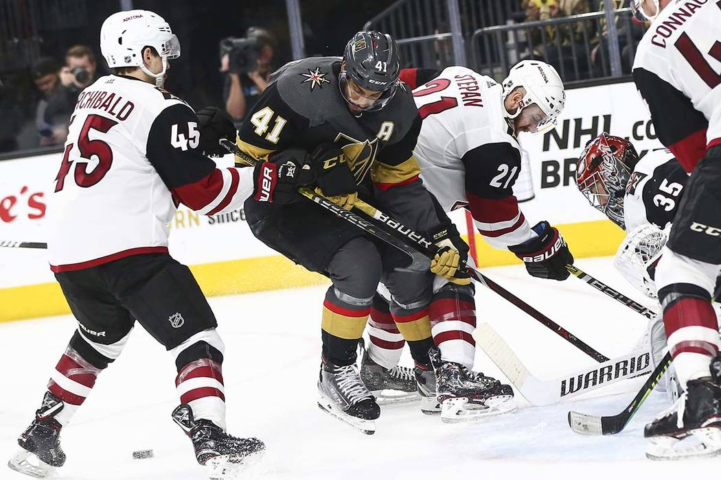Golden Knights center Pierre-Edouard Bellemare (41) and Arizona Coyotes right wing Josh Archiba ...