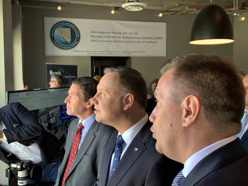 President of Poland Andrzej Duda watches a demonstration of a drone deploying in an urban envir ...