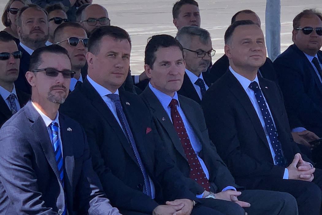 President of Poland Andrzej Duda and others await the landing of a drone at the Reno-Stead Airp ...
