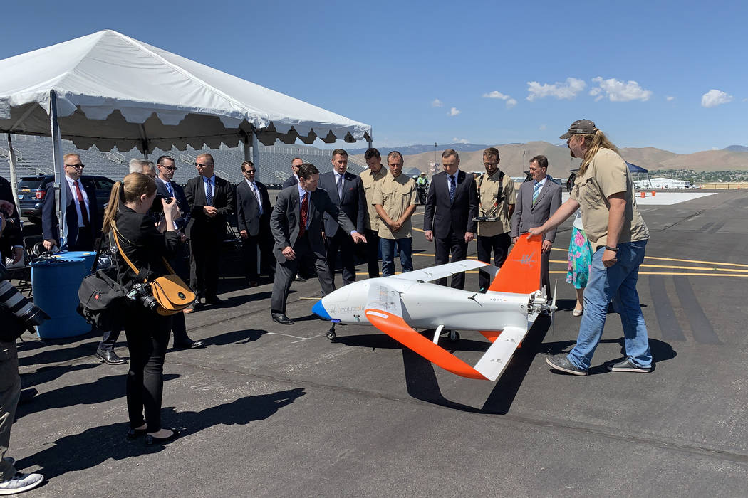 President of Poland Andrzej Duda with the drone demonstration team and their vehicle at the Ren ...