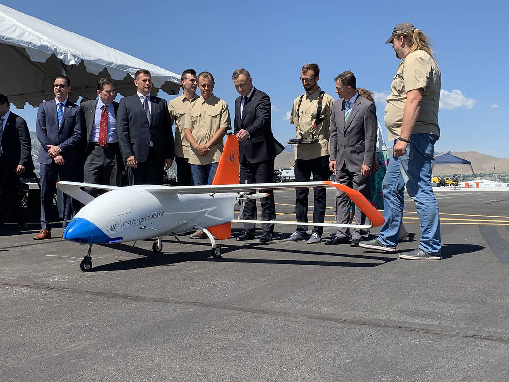 President of Poland Andrzej Duda poses for photos with the drone team at the Reno-Stead Airport ...