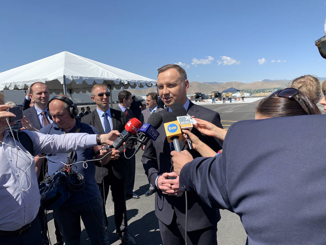 President of Poland Andrzej Duda, at the Reno-Stead Airport Saturday, speaks to Polish reporter ...