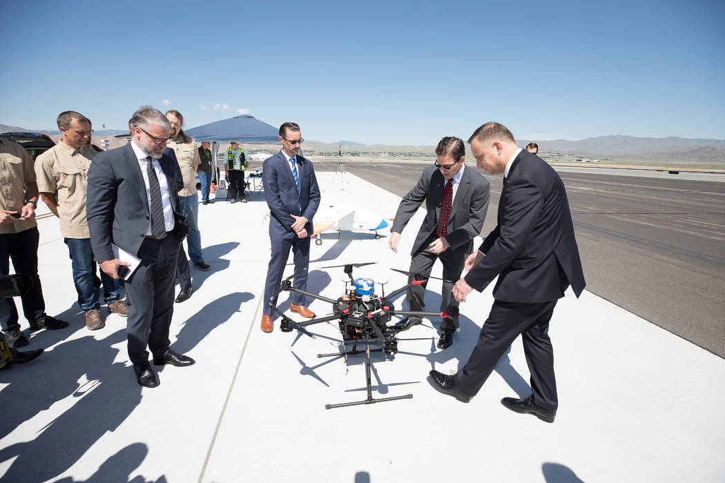 President of Poland Andrzej Duda, right, and Chris Walach, executive director the Nevada Instit ...