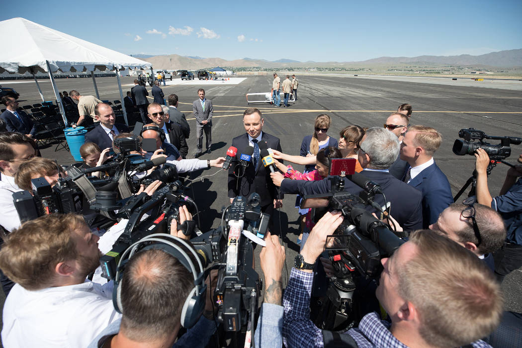 President Duda, at the Reno-Stead Airport Saturday, speaks to Polish reporters traveling with h ...