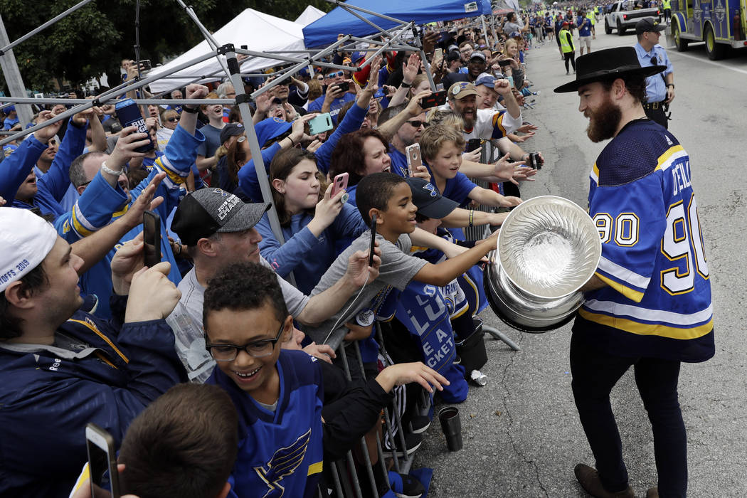 St. Louis Blues center Ryan O'Reilly carries the Stanley Cup during the Blues' NHL hockey Stanl ...
