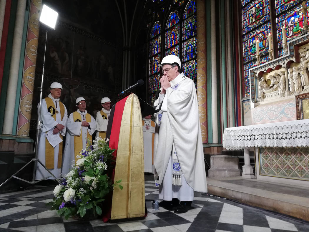 The Archbishop of Paris Michel Aupetit leads the first mass in a side chapel, two months after ...