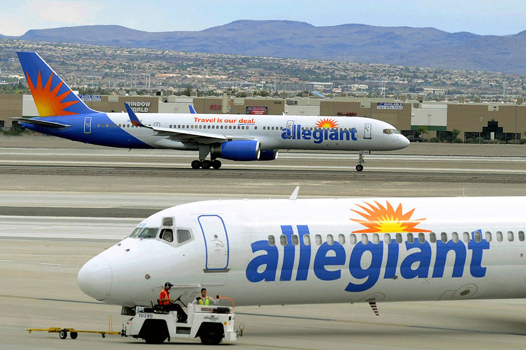 File - In this May 9, 2013, file photo, two Allegiant Air jets taxi at McCarran International A ...