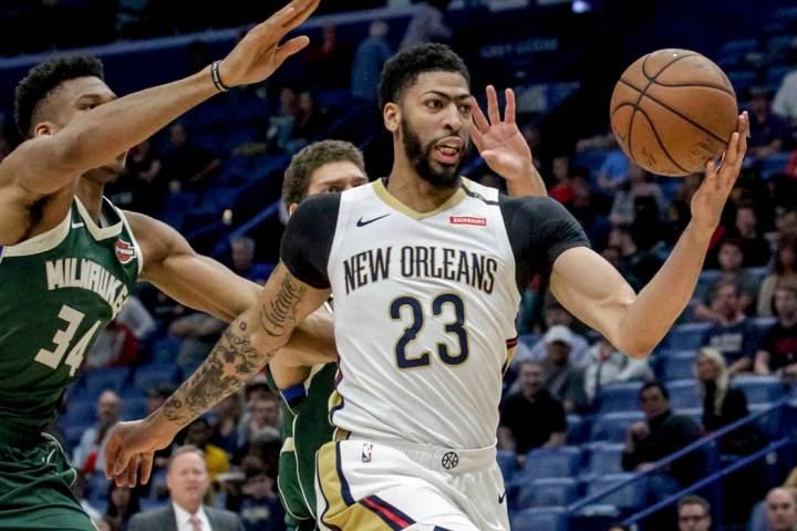 New Orleans Pelicans forward Anthony Davis takes an outlet pass against Milwaukee Bucks forward ...