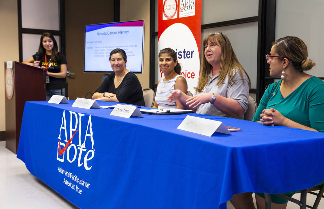 A roundtable on census takes place during an Asian Community Development Council sponsored semi ...