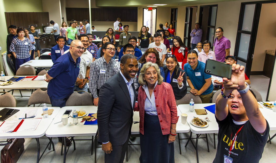 U.S. Reps. Steven Horsford, left, and Dina Titus pose for a group selfie taken by Duy Nguyen, r ...